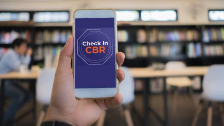 Image of phone with Check in CBR app displayed