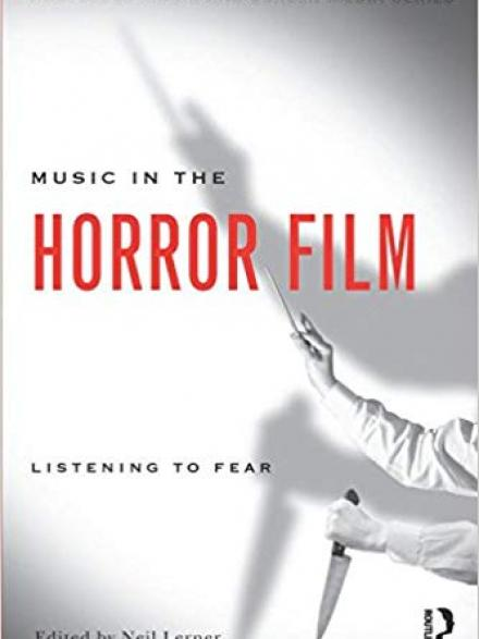 "Book cover shows person holding knife in one hand, conductors baton in the other. Text reads ""Music in the horror film: listening to fear """
