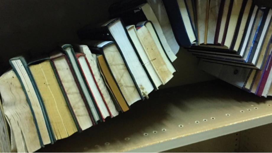 Books bulging in their shelves following the 2018 Chifley Flood