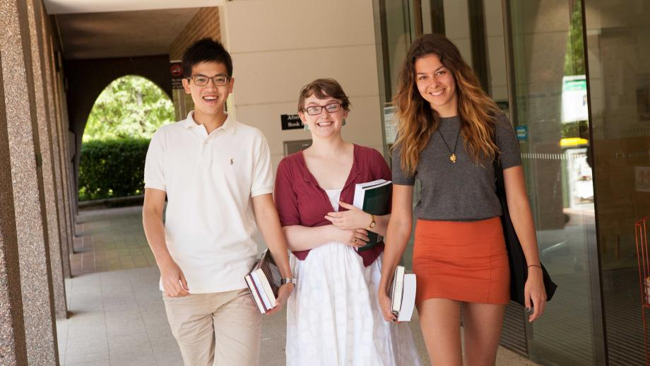 Three ANU students outside the Chifley Library